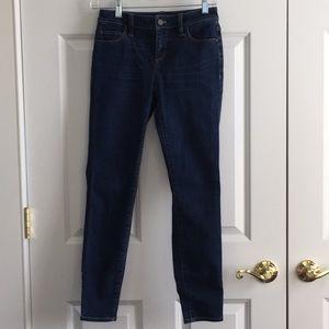 Stretch mid waist skinny jeans dark wash
